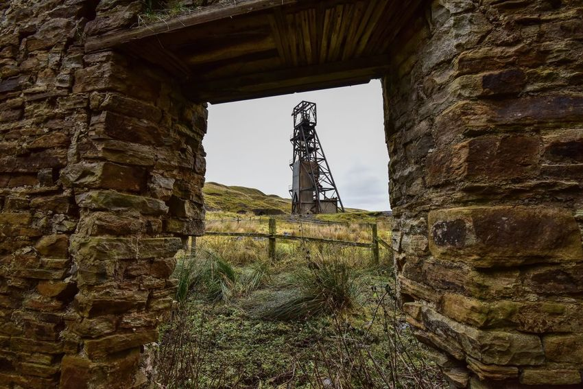 Low Angle View Built Structure Landscape Outdoors Sky Nikonphotography Pit Wheel Mine Stone Material Looking Through Nikon Eye4photography  Building Historical Building Countryside Abandoned Places Abandoned Buildings Abandoned & Derelict