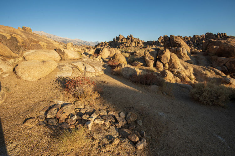 View of rock formations in desert against sky