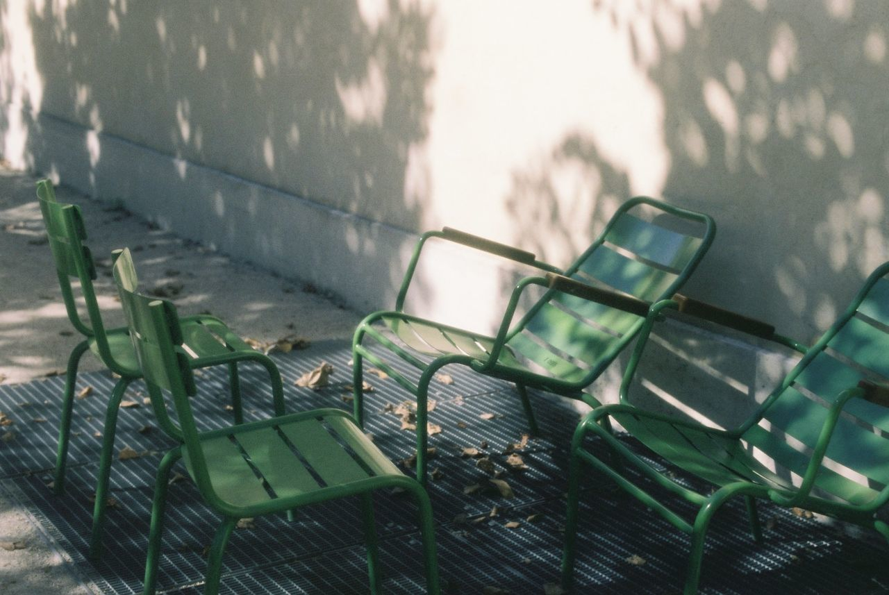 Empty chairs by building