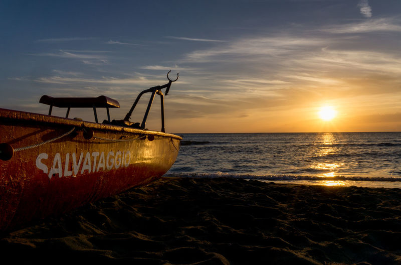 sunset with a rescue boat on the beach Beach Boat Cloud - Sky Coastline Horizon Over Water No People Orange Color Rescue Rescue Boat Scenics Sea Sea And Sky Sea Sunset Sky Sun Sunset Sunset On The Beach Water