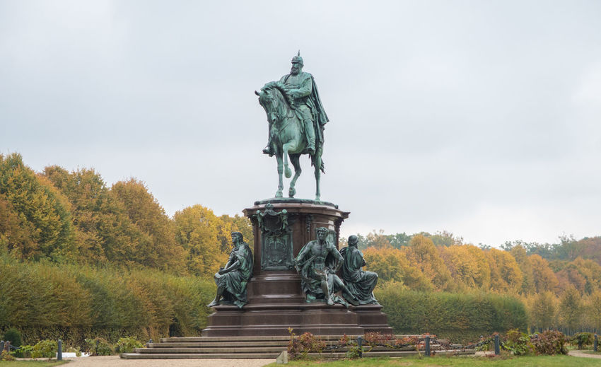 Statue of Schwerin Castle, Schwerin, Germany Representation Sculpture Art And Craft Statue Human Representation Male Likeness Architecture Day Horse Tree Plant Sky No People Nature Memorial Creativity History Mammal Low Angle View Outdoors Government