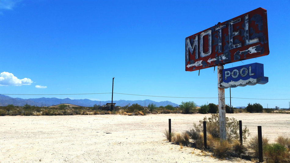 Abandoned motel sign along Route 66 in California. Abandoned Arrow Symbol Blue Copy Space Desert Disrepair Empty Falling Apart Landscape Motel Motel Sign Neon Neon Sign Route 66 Seen Better Days Sign Sky Urban Exploration Kiomi Collection My Favorite Photo The Great Outdoors With Adobe California Dreamin