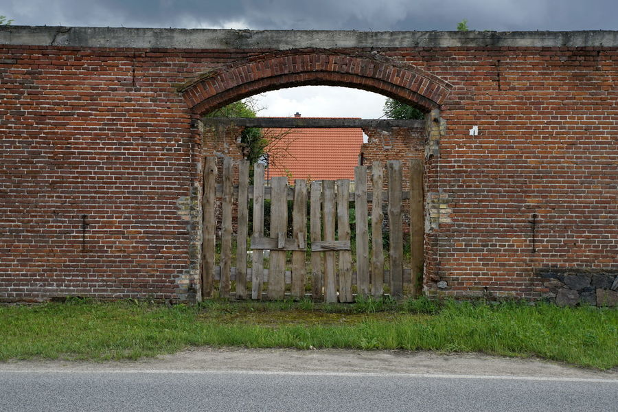 Arch Architecture Barn Brick Wall Building Exterior Built Structure Closed Day Door Grass No People Outdoors