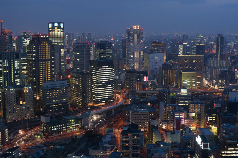 Panoramic view of Osaka Japan by night Buildings Business Busy City City Cityscape Corporate Crowded Darkness Dusk Glow Illuminated Japan Japanese  Light Lit Metropolitan Modern Night Office Building Offices OSAKA Skyscraper Tower Urban