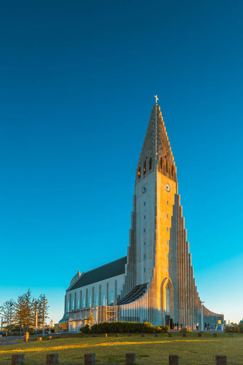 Architecture Building Exterior Business Finance And Industry City Clear Sky Clock Clock Tower Day History Iceland No People Outdoors Place Of Worship Reykjavik Sky Travel Destinations