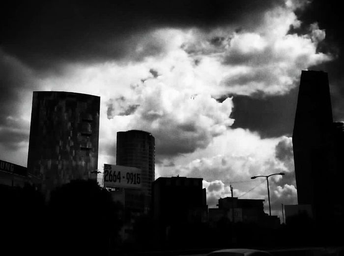 Architecture Cloud - Sky Building Exterior Built Structure Sky Skyscraper City No People Outdoors Factory Industry Storm Cloud Smoke Stack Urban Skyline Cityscape Modern Day Black And White Photography Black And White Collection  Blackandwhite Black & White
