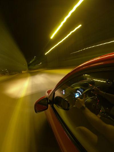 Close-up of illuminated car lights at night