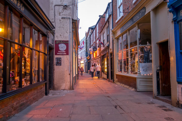 Whitby Whitby North Yorkshire Whitby View Seaside Seaside Town Whitby Streets Yorkshire Town Centre Coastal Town Holiday Destination Tourist Hotspot Shops Street Streets Alley Outdoors The Way Forward Store Building Building Exterior Architecture Built Structure City Walking Footpath