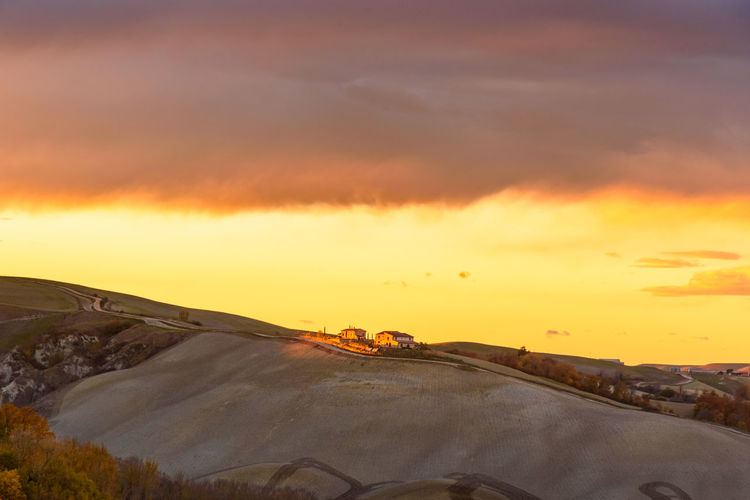 Last days of autumn Crete Senesi Torre A Castello Tuscany Tuscany Countryside Beauty In Nature Cloud - Sky Day Dramatic Sky Landscape Nature No People Orange Color Outdoors Scenics Siena Sky Sunset Tranquility Transportation