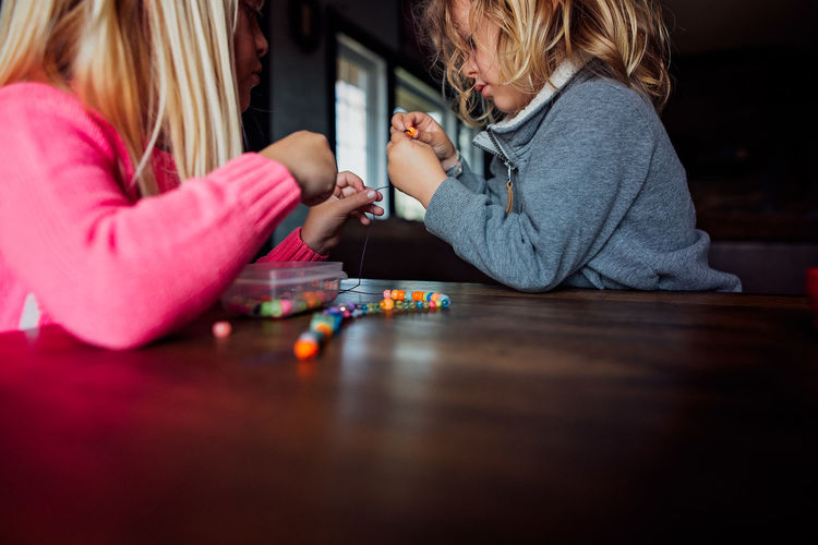 Girl playing with toy on table