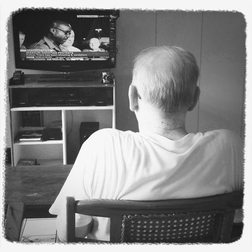 fr. chris, omi watching bbc news. First Eyeem Photo