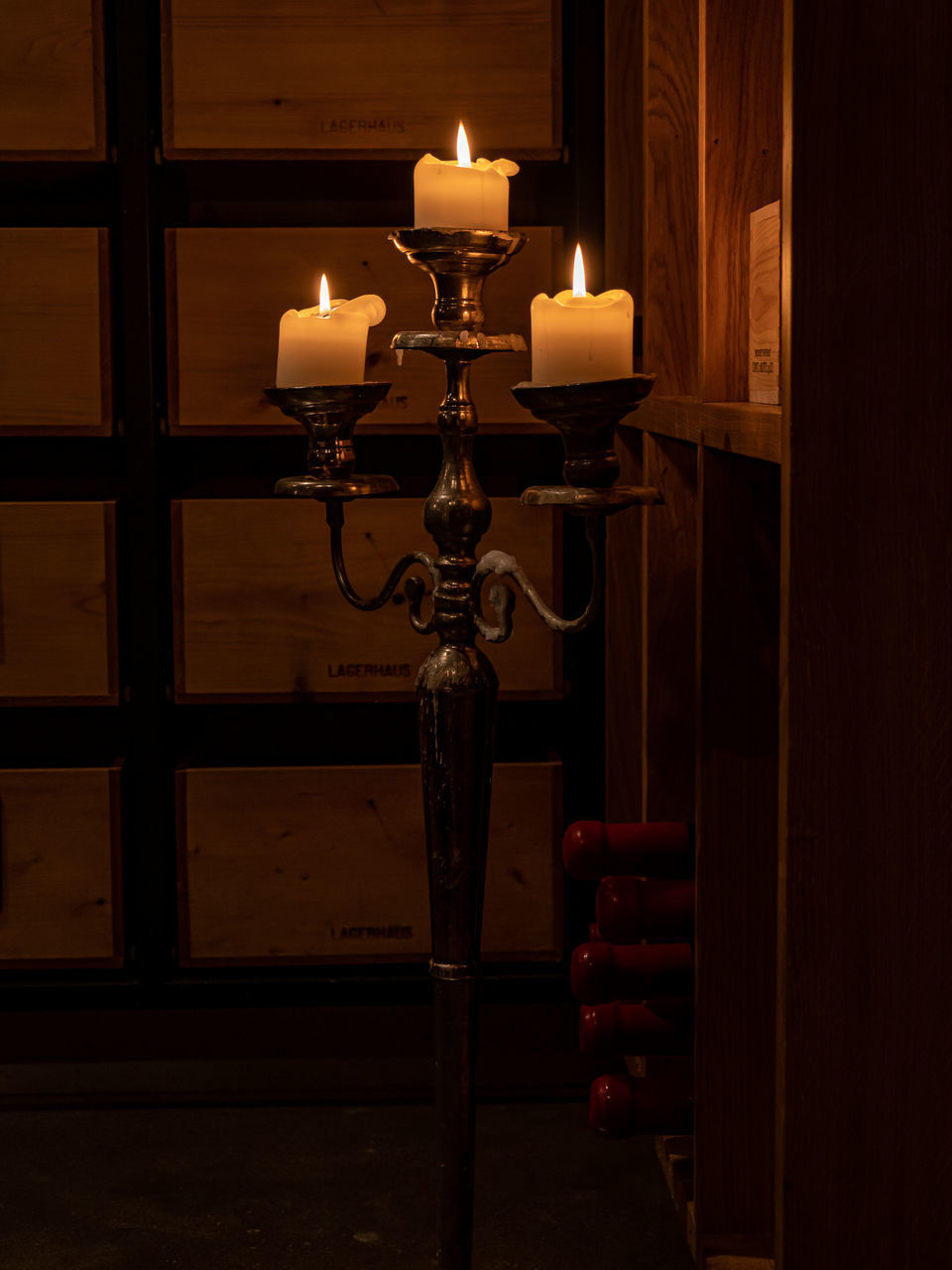 candle, flame, fire, burning, indoors, fire - natural phenomenon, illuminated, heat - temperature, candlestick holder, no people, glowing, lighting equipment, close-up, wood - material, nature, domestic room, dark, building, architecture, spirituality, tea light