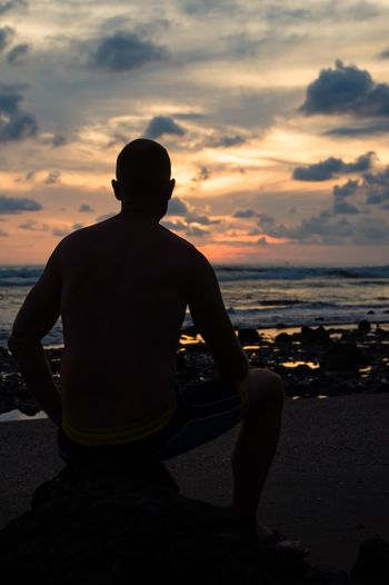 Watching sunset Bali, Indonesia INDONESIA Balianbeach Sunset Sea Silhouette Beach One Person Water Sky