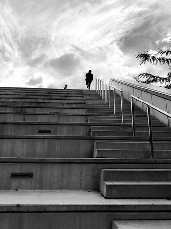 Glòries Streetphotography Iphoneonly Iphonephotography IPhoneography BW_photography Bw_collection Blackandwhite Stretphoto_bw Black & White Bws_worldwide Eye4photography  EyeEmNewHere Cloud - Sky Stairstoheaven Stairs Staircase Architecture Steps And Staircases Sky Cloud - Sky Low Angle View Railing Real People One Person Building Exterior Outdoors