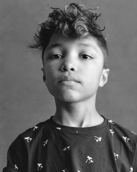 Portrait of boy against wall at home