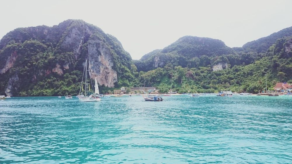 Mountain Water Boat Waterfront Beauty In Nature Blue Water Hill Mountain Range Islandlife Koh Phiphi Thailand Summer Vibes Nature Photography Holiday Traveling Ocean