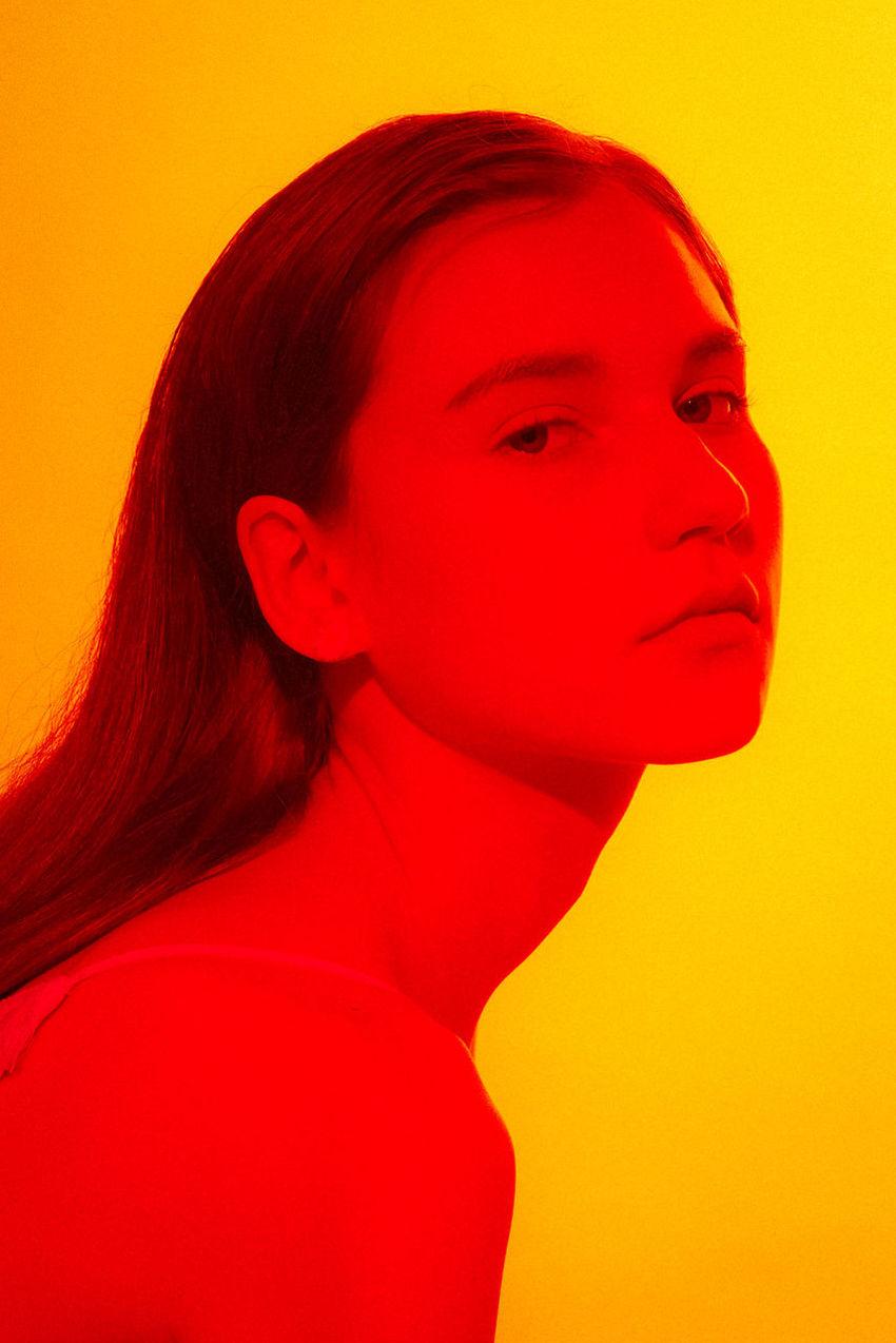 Colored Background Headshot Indoors  Long Hair Marcfashionvn One Person Orange Color Portrait Profile View Red Studio Shot
