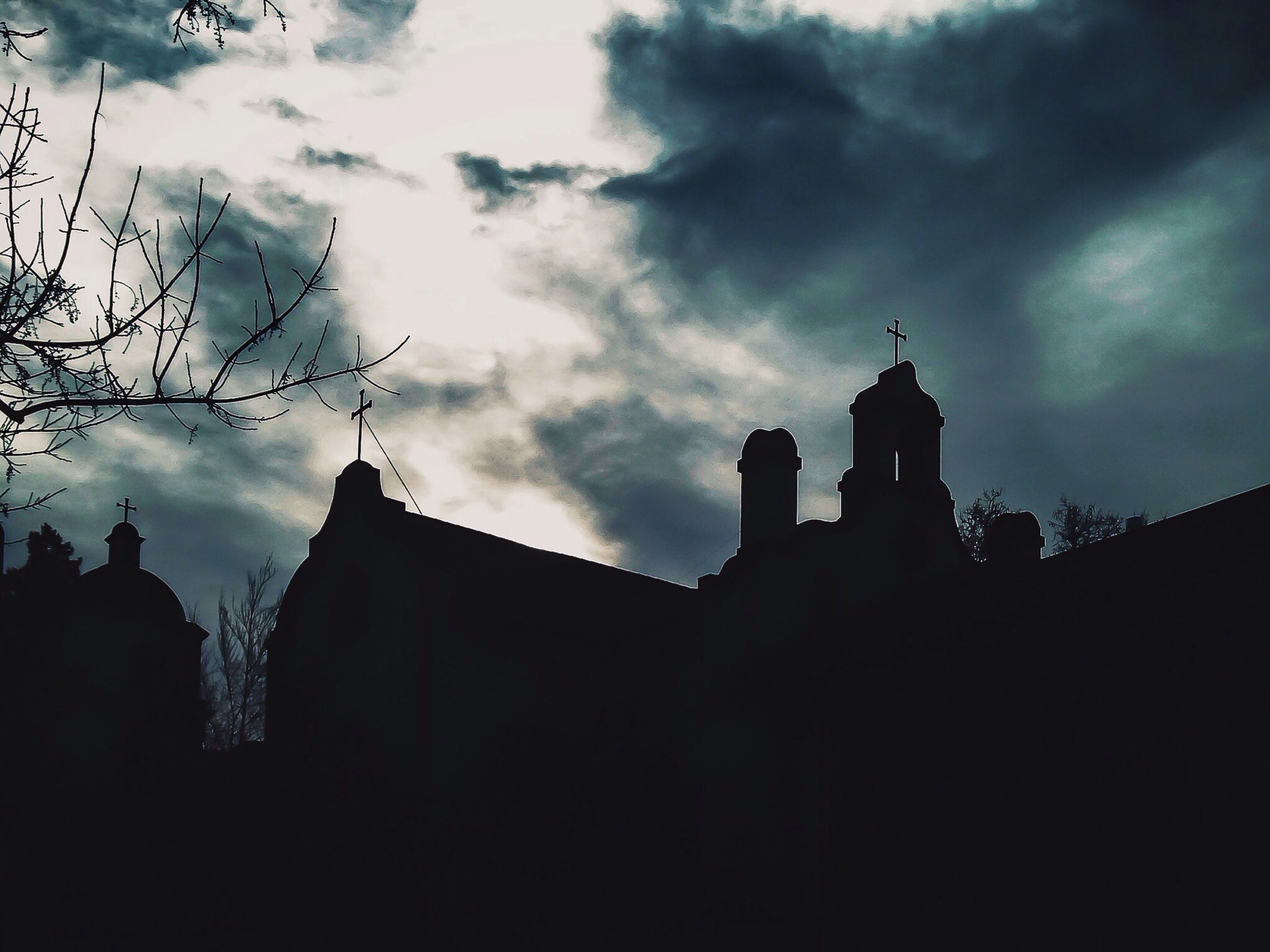architecture, building exterior, built structure, sky, silhouette, religion, place of worship, church, spirituality, cloud - sky, low angle view, cloudy, cloud, dusk, cathedral, cross, steeple, history