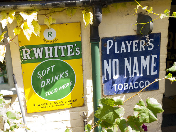 Man Cave Signs in back garden Shoreham Kent Advertising Back Shed Black Out Board City Communication Day Guidance Hovis Kent Looting Lyons Tea Man Cave News Of The World No People Old Tin Signs Outdoors Plane Wreckage Road Sign Robinsons Signs Text Village Vivid International