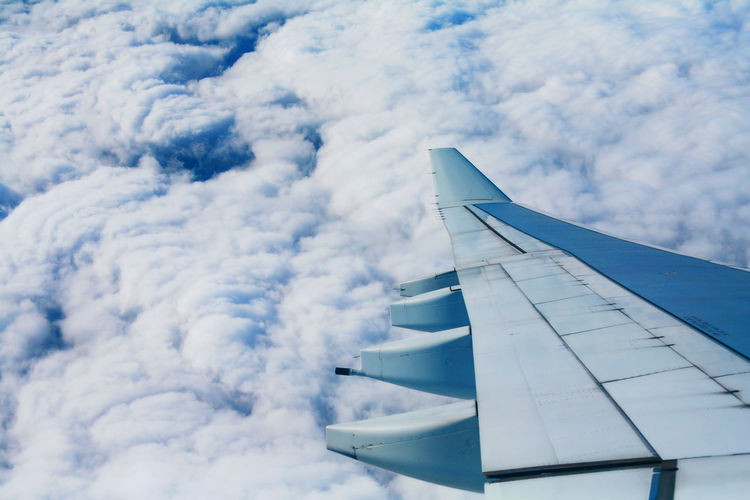 Aerial View Air Vehicle Aircraft Wing Airplane Airplane Wing Beauty In Nature Blue Close-up Cloud - Sky Day Flying Journey Mid-air Mode Of Transport Nature No People Outdoors Scenics Sky Transportation Travel Vehicle Part