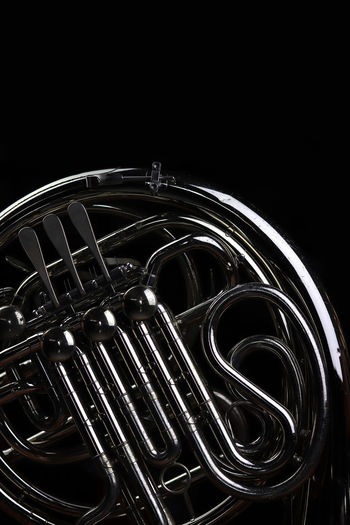 Music Instrument French Horn Music Musical Instrument Black Background Arts Culture And Entertainment Metal Studio Shot Brass Instrument  Indoors  Brass No People Close-up Wind Instrument Copy Space Musical Equipment Equipment Dark Night Trumpet Complexity Shiny