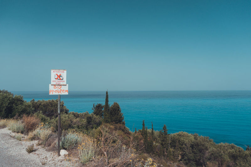 Sea No People Outdoors Clear Sky Tranquility Horizon Over Water Water The Great Outdoors - 2017 EyeEm Awards Summer Sign Letters Warning Sign Nature Beauty In Nature Blue Lefkada