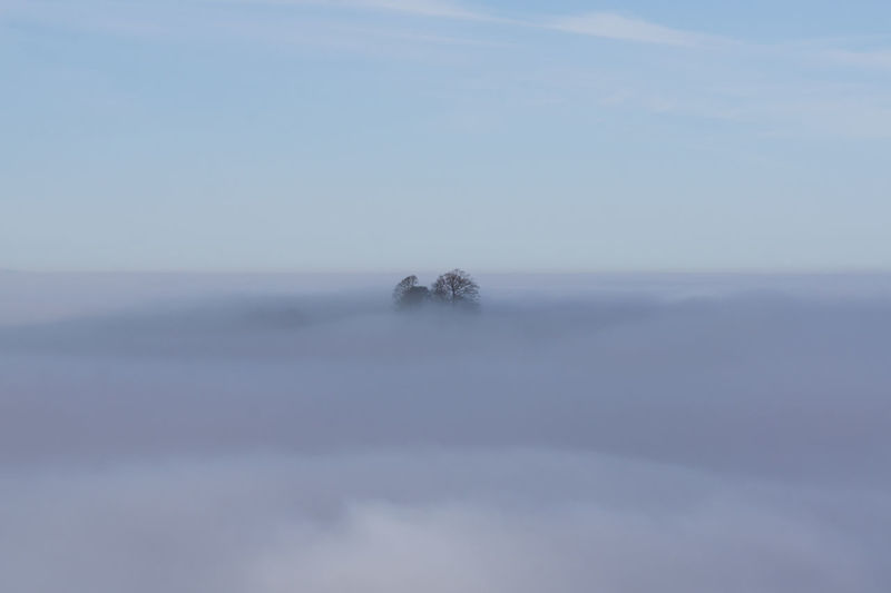 Scenic view sea of fog against sky