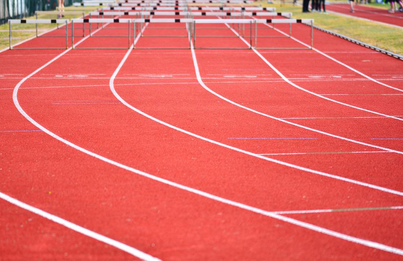 High angle view of hurdles on running track