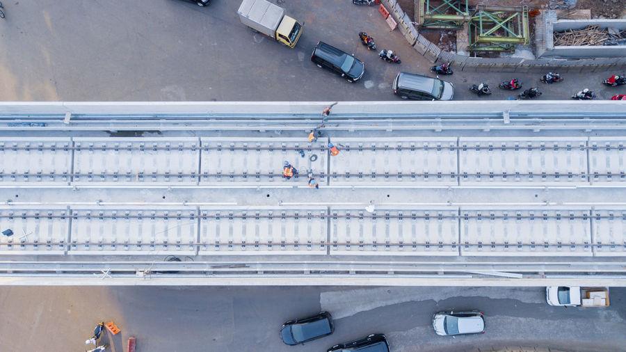 Directly Above Shot Of Railway Bridge Over Road In City