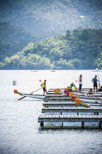 People Rowing Boats At Dragon Boat Festival
