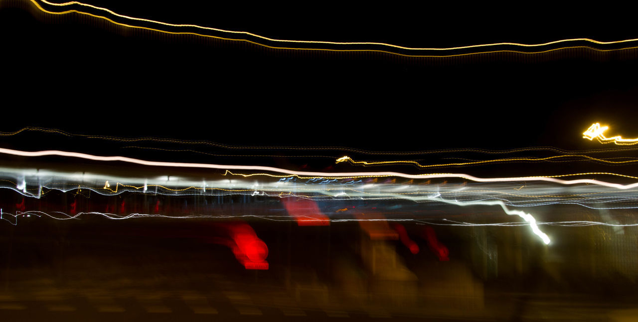 illuminated, motion, night, water, abstract, no people, pattern, red, light trail, studio shot, long exposure, black background, technology, backgrounds, nature, close-up, outdoors