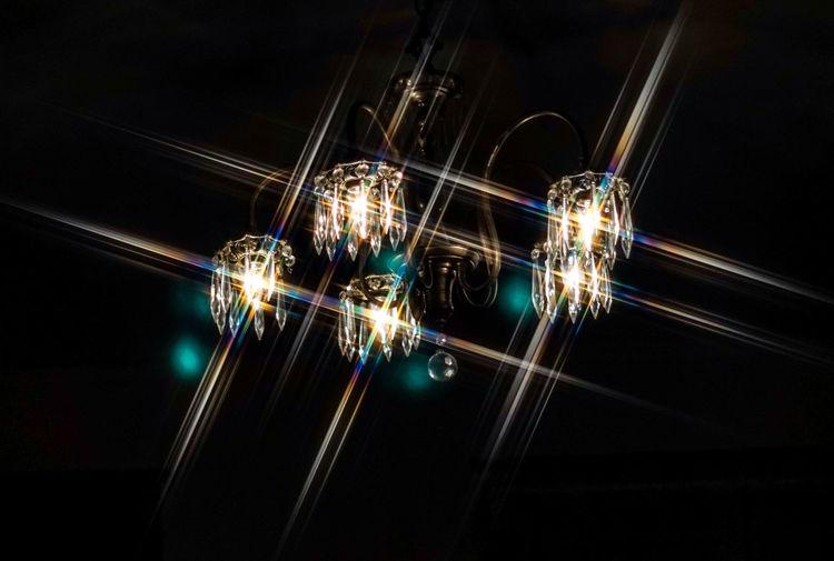Close-up of illuminated light trails over black background