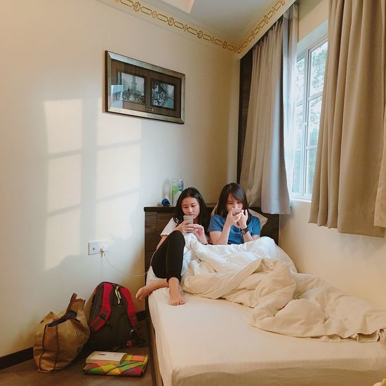 Morning 🌞 Bed Indoors  Bedroom Togetherness Family Daughter Girls Mother Domestic Life Real People Home Interior Sitting Family With One Child Childhood Leisure Activity Elementary Age Lifestyles Window Relaxation Sibling
