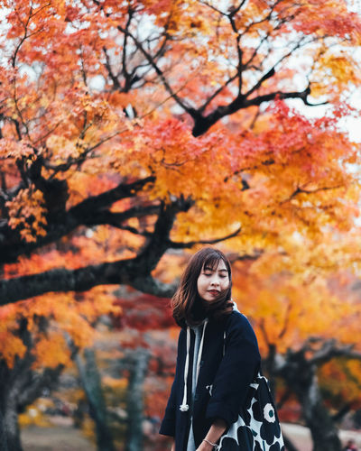 Feel Free Tree Autumn One Person Change Real People Leisure Activity Lifestyles Plant Portrait Young Women Nature Young Adult Leaf Looking At Camera Day Women Plant Part Standing Focus On Foreground Orange Color Outdoors Hairstyle Beautiful Woman Contemplation Warm Clothing It's About The Journey