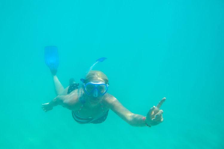 Portrait of woman snorkeling in sea