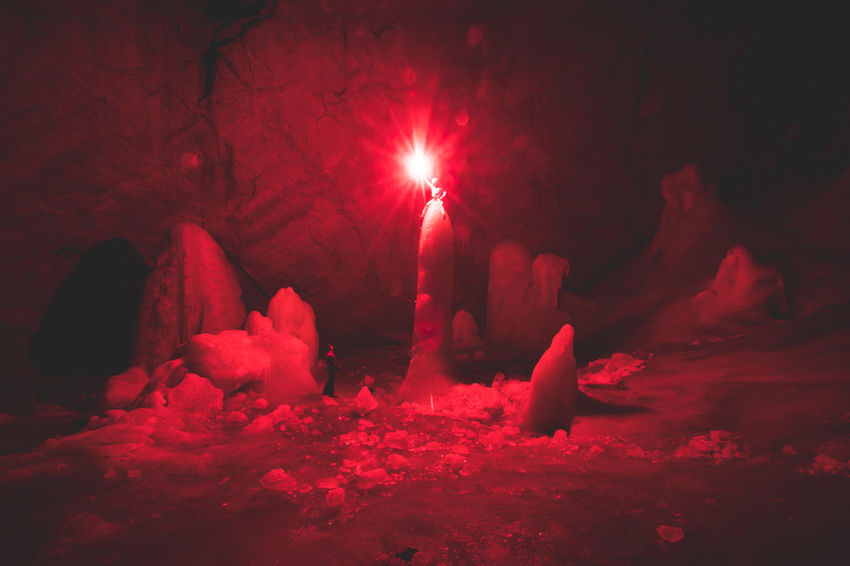 bringing light into this huge dark cave... making it look like not from this world Breathing Space Exploring Friends Adventure Beauty In Nature Cave Climbing Cold Temperature Colorful Ice Climbing Nature Outdoors Red Snow Tranquility Winter