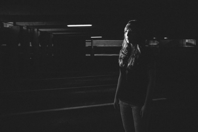 Full length of woman standing at night