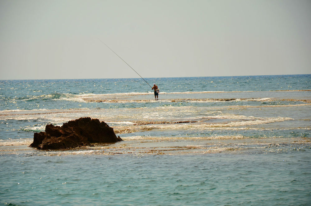Beauty In Nature Byblos Byblos,Lebanon Day Enjoyment Fisherman Fishing Horizon Over Water Idyllic Leisure Activity Lifestyles Nature Outdoors Remote Rippled Scenics Sea Seascape Shore Sky Tranquil Scene Tranquility Vacations Water Wave