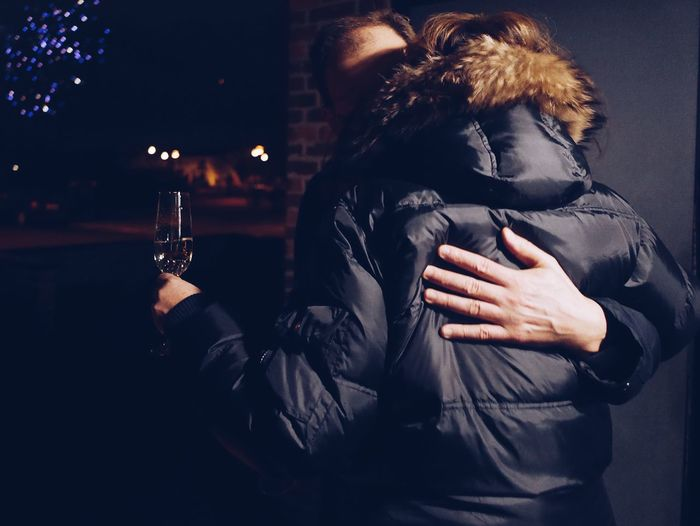 Celebration Full Frame Hugging Street Real People One Person Drink Lifestyles Refreshment Women The Art Of Street Photography Leisure Activity Illuminated Food And Drink Adult Alcohol Night Holding Waist Up Young Women Warm Clothing Front View Glass