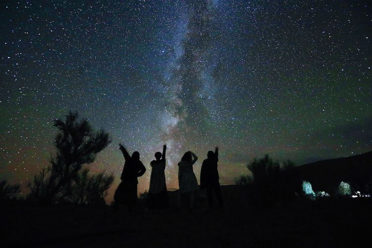 StarryNight Night Silhouette Star - Space Astronomy Sky Beauty In Nature Nature Star Field Real People Medium Group Of People Outdoors Togetherness Leisure Activity Scenics Lifestyles Galaxy Standing Space Constellation Milky Way Desert Stars