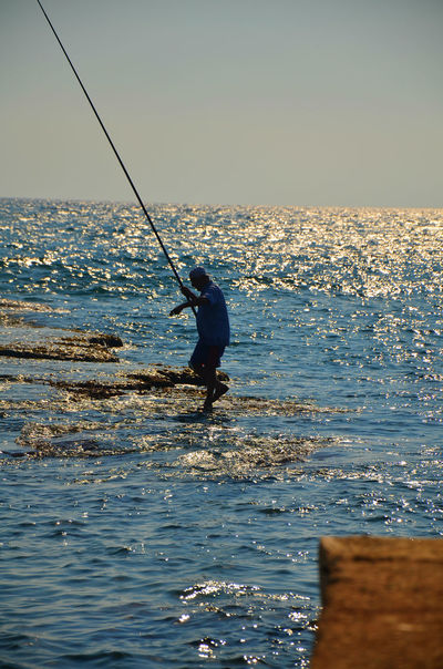 A man's daily fishing routine Beauty In Nature Byblos Byblos,Lebanon Catch Of The Day Day Fisherman Fishing Fishing Rod Horizon Over Water Idyllic Leisure Activity Lifestyles Nature Outdoors Rippled Scenics Sea Sky Tranquil Scene Tranquility Vacations Water