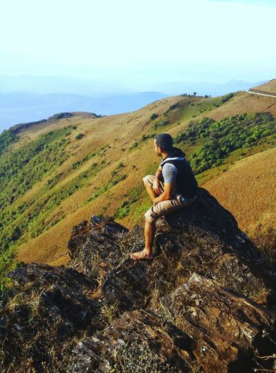 Enjoying the view Mullayanagiri Rock - Object View Nature Nature Photography Mountain Men Full Length Sitting Sky Landscape Countryside Calm Rock Formation My Best Photo