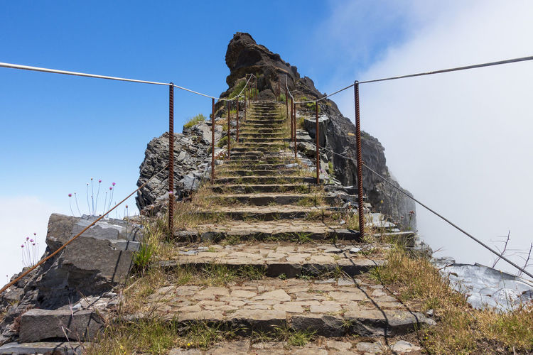 Stairway on Pico do Arieiro, Madeira Portugal Heaven Madeira Point Of Interest Portugal Rock Security Stairway Trekking Banister Clouds Cobblestone Pavement Danger Dangerous Landscape Mountain Mountain Range Nature No People Outdoors Peak Sky Steep Stones Summerly Track