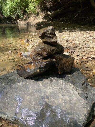 Rocks by river stream in forest