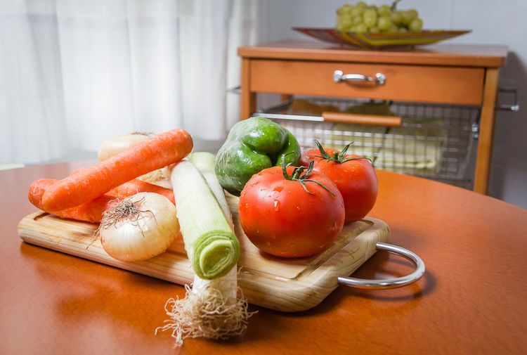 Close-up of fruits and vegetables on cutting board