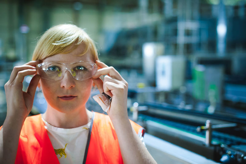 Portrait Of Woman In Protective Eyewear At Factory