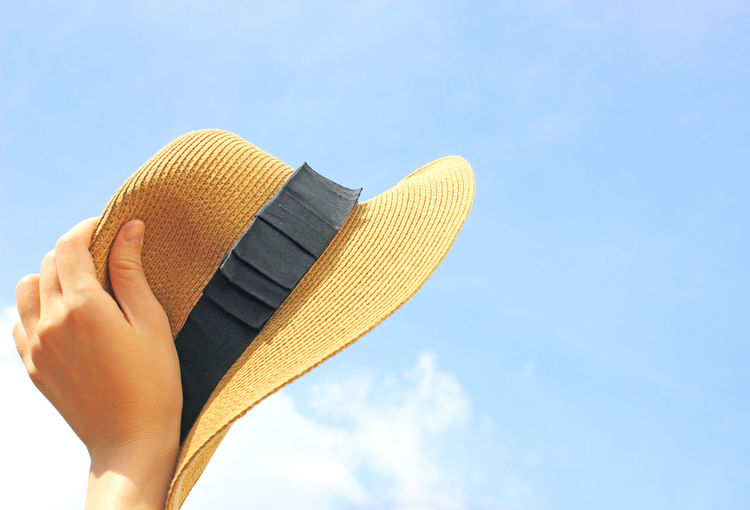 Human Body Part One Person Body Part Human Hand Sky Hand Real People Personal Perspective Human Leg Lifestyles Unrecognizable Person Blue Low Angle View Nature Day Low Section Close-up Cloud - Sky Outdoors Finger Woman Women Hat Summertime Fashion Clothing