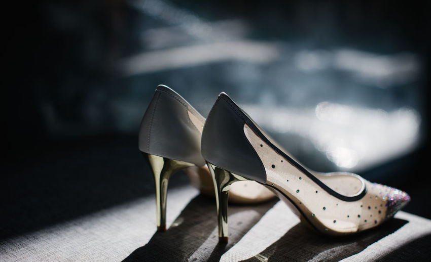 Close-up of shoes on table