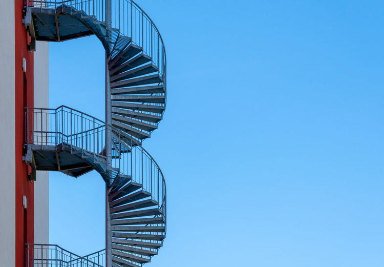 Low Angle View Of Spiral Staircase Against Clear Blue Sky