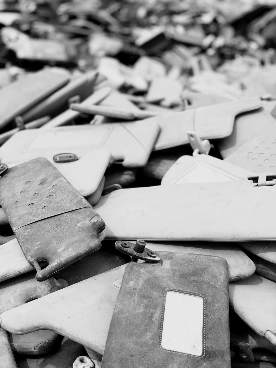 large group of objects, still life, no people, focus on foreground, indoors, close-up, table, heap, abundance, variation, choice, stack, paper, art and craft, selective focus, messy, day, craft, abandoned, equipment, leather